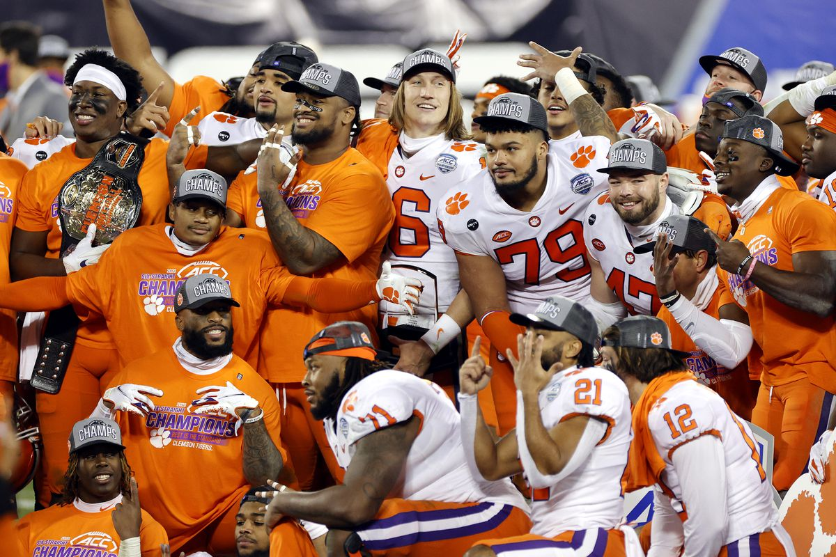 Clemson Tigers players pose after defeating the Notre Dame Fighting Irish 34-10 in the ACC Championship game at Bank of America Stadium on December 19, 2020 in Charlotte, North Carolina.