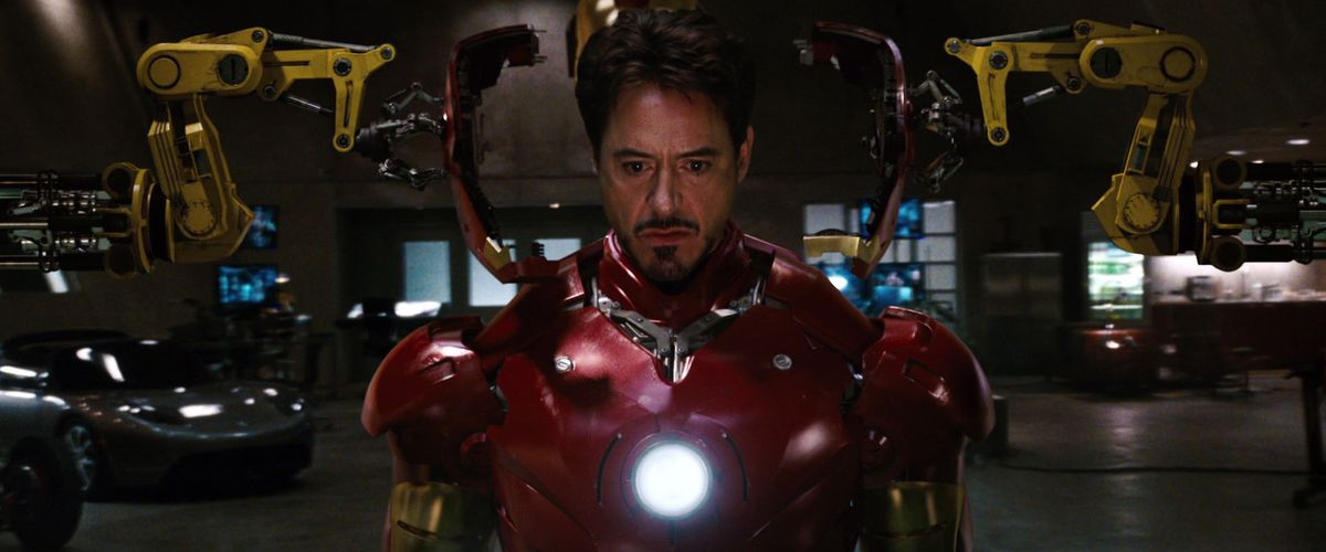 tony stark suits up in the mark III armor in iron man (2008)