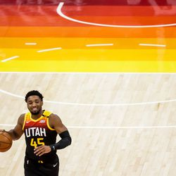 Utah Jazz guard Donovan Mitchell (45) smiles on the court during the game against the Oklahoma City Thunder at Vivint Smart Home Arena in Salt Lake City on Tuesday, April 13, 2021.