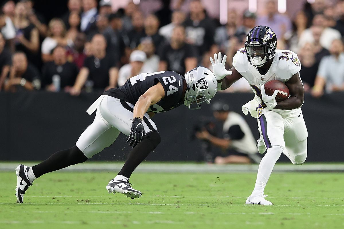 Running back Ty'Son Williams #34 of the Baltimore Ravens rushes the football against defensive back Johnathan Abram #24 of the Las Vegas Raiders during the NFL game at Allegiant Stadium on September 13, 2021 in Las Vegas, Nevada.