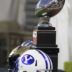 Helmets are displayed with the Boca Raton Bowl trophy in Boca Raton, Florida, on Tuesday, Dec. 22, 2020.
