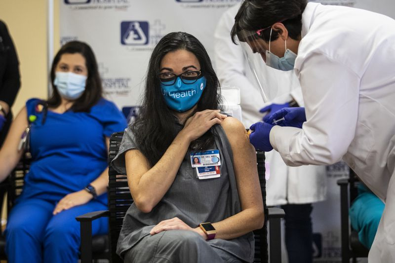 Dr. Marina Del Rios, from University of Illinois Hospital & Health Sciences System, gets her 2nd and final dose of the vaccination at Norwegian American Hospital Jan. 5, 2021.