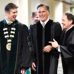 Former presidential candidate and Massachusetts Gov. Mitt Romney, center, laughs with Utah Gov. Gary Herbert, right, and UVU President Matthew Holland at Utah Valley University in Orem on Thursday, April 30, 2015.