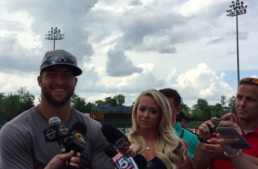 Tebow talks with the local press before BP.