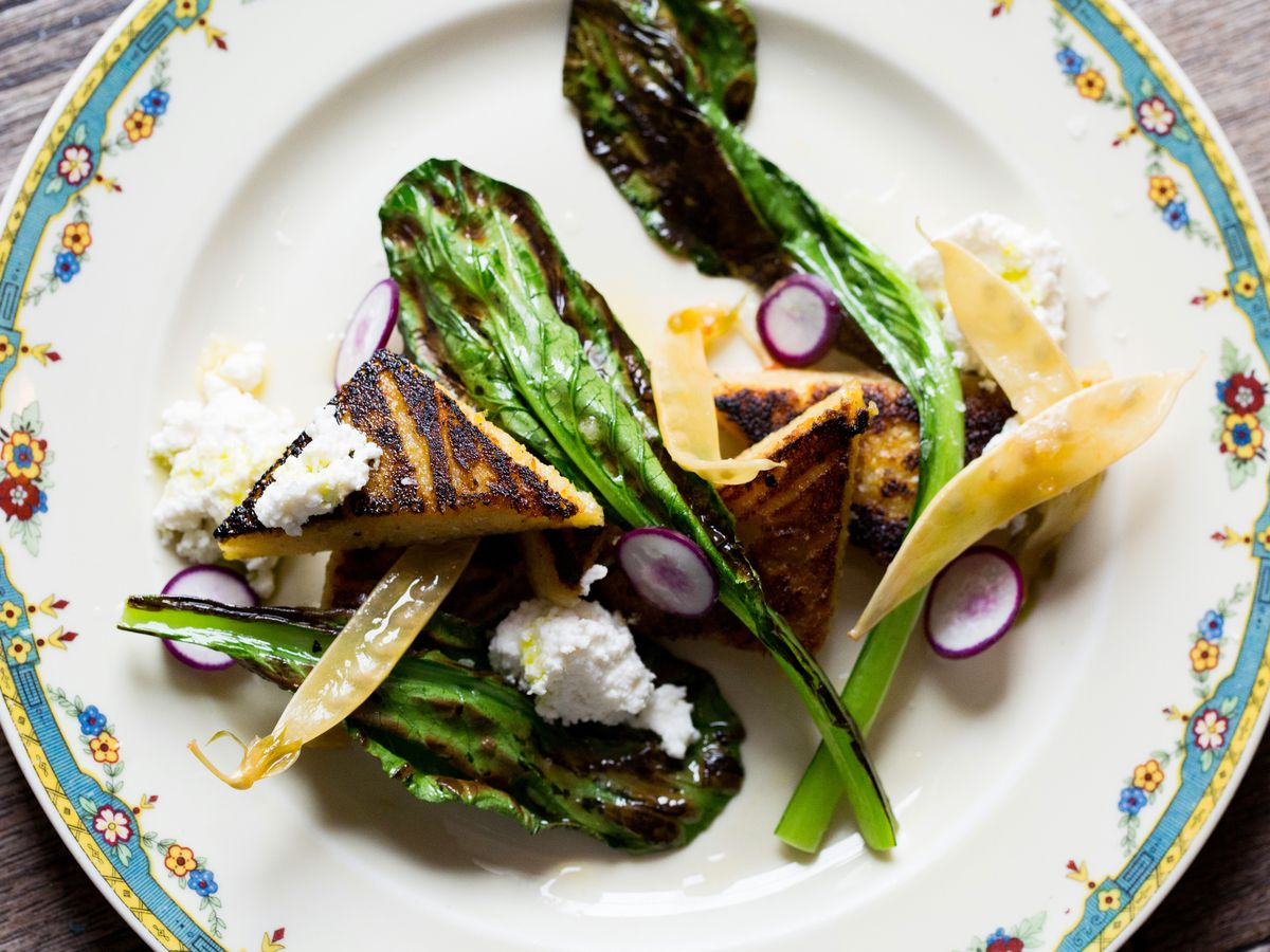 china plate with greens and grilled polenta