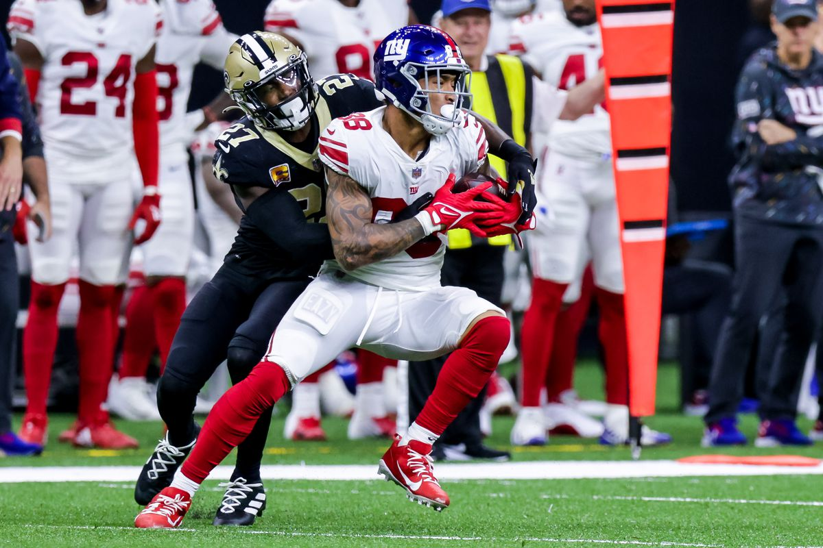 New York Giants tight end Evan Engram (88) is tackled by New Orleans Saints strong safety Malcolm Jenkins (27) during the second half at Caesars Superdome.