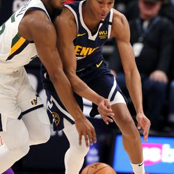 Denver Nuggets guard PJ Dozier (35) steals the ball from Utah Jazz guard Donovan Mitchell (45) as the Utah Jazz and the Denver Nuggets play an NBA basketball game at Vivint Arena in Salt Lake City on Wednesday, Feb. 5, 2020. Denver won 98-95, giving the Jazz their fifth straight loss.