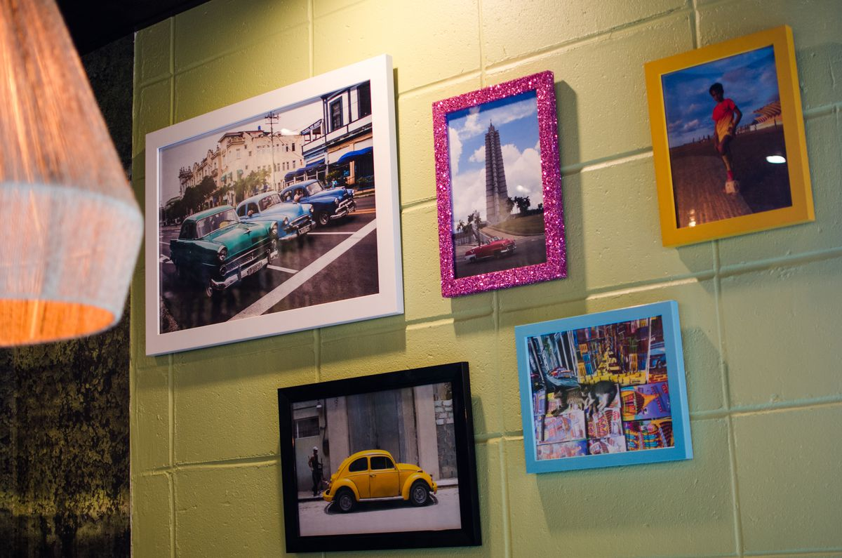 Some of the Cuba photographs by Lucy Sargent Lyons that adorn the walls of Casa Caña