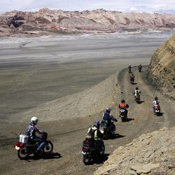 """Cyclists ride toward the San Rafael Swell during """"A Ride to Remember"""". This motorcycle ride in Southern Utah honored Joe Jorgensen, a youth leader who influenced the lives of most of these men. Wednesday, June 3, 2009. Ravell Call, Deseret News"""
