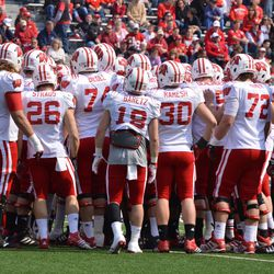 Wisconsin's offense huddles before the spring game.