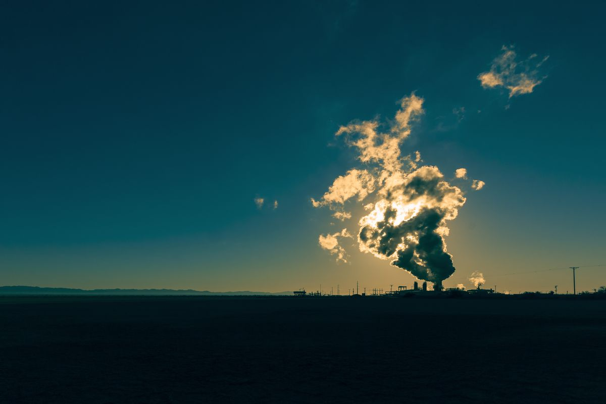 Sunlight glows through the steam of a geothermal power plant in Niland, California.
