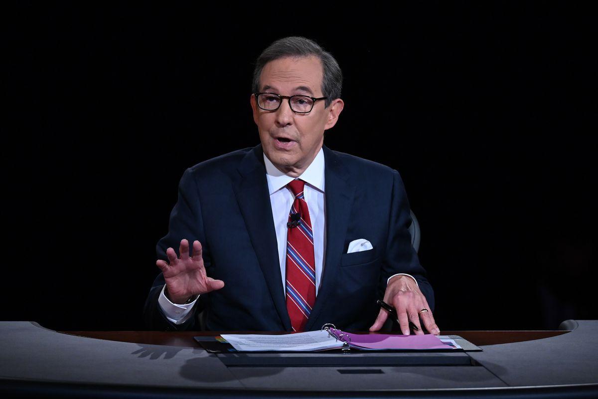 Chris Wallace of Fox News moderates a presidential debate between then-President Donald Trump and President Joe Biden.
