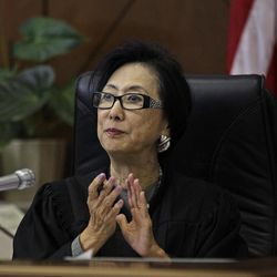 Judge Lillian Sing applauds a defendant on the bench of the Community Court Tuesday, Sept. 18, 2012, in San Francisco. While it's been difficult for researchers to determine cost savings by the courts, new studies suggest the courts are helping stem crime. An evaluation of Washington, D.C.'s community court by the Westat research firm found this summer that defendants who successfully completed diversion programs from 2007 to 2009 were half as likely to reoffend as similar defendants in a traditional court.