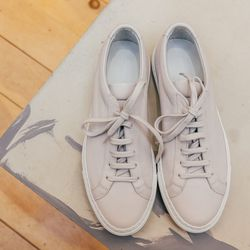 """""""No doubt a perfect pair of sneakers is this season's must. The Achilles from Common Projects has been a customer favorite, due to the unique blush tone that complements any outfit."""" <b>Woman by Common Projects</b> sneakers, <a href=""""http://www.spirituala"""