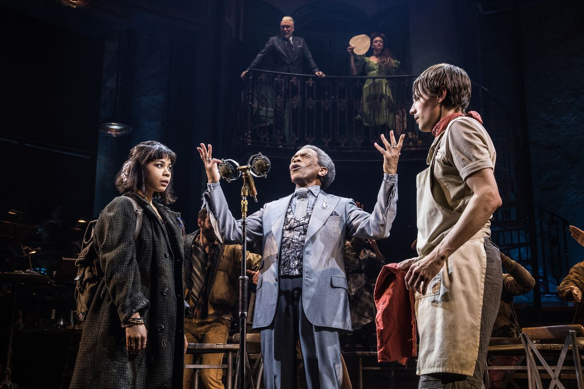 In the center, André de Shields holds forth as Hermes. In the foreground, Eva Noblezadaas Eurydice and Reeve Carney as Orpheus. In background, Patrick Page and Amber Gray as Hades and Persephone.