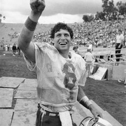 """Brigham Young University quarterback Steve Young responds to BYU fans with a """"Number One"""" show of the finger as he departs the field after leading his team to a 37-35 victory over UCLA at the Pasadena Rose Bowl, Oct. 1, 1983. (AP Photo/Doug Pizac)"""