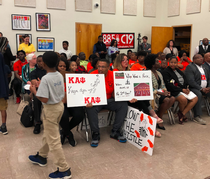 Members of parent advocacy organization Memphis Lift show support for a national search for the district's next superintendent.