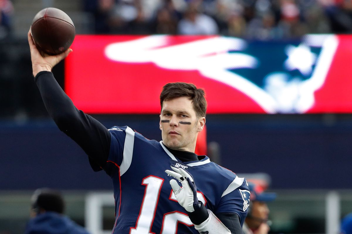 New England Patriots quarterback Tom Brady warms-up on the sidelines during the second half against the Miami Dolphins at Gillette Stadium.