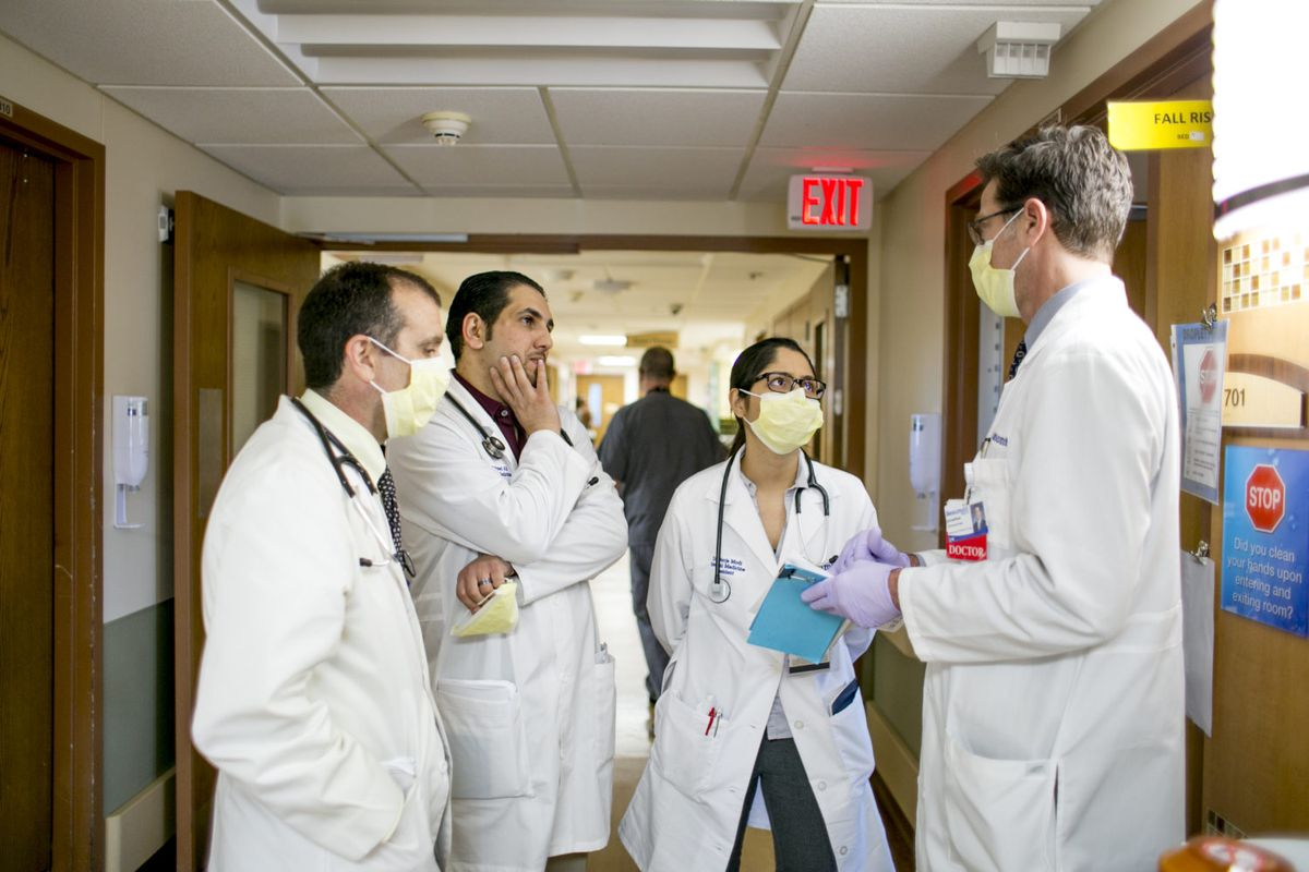 Dr. Jonathan Zimmerman, director of educational development at Beaumont Hospital -Dearborn, travels around the hospital with doctors-in-training including a medical student, a resident and an intern, stopping to ask them what they've learned from each patient. It's a model the University of Michigan wants to apply to training teachers.