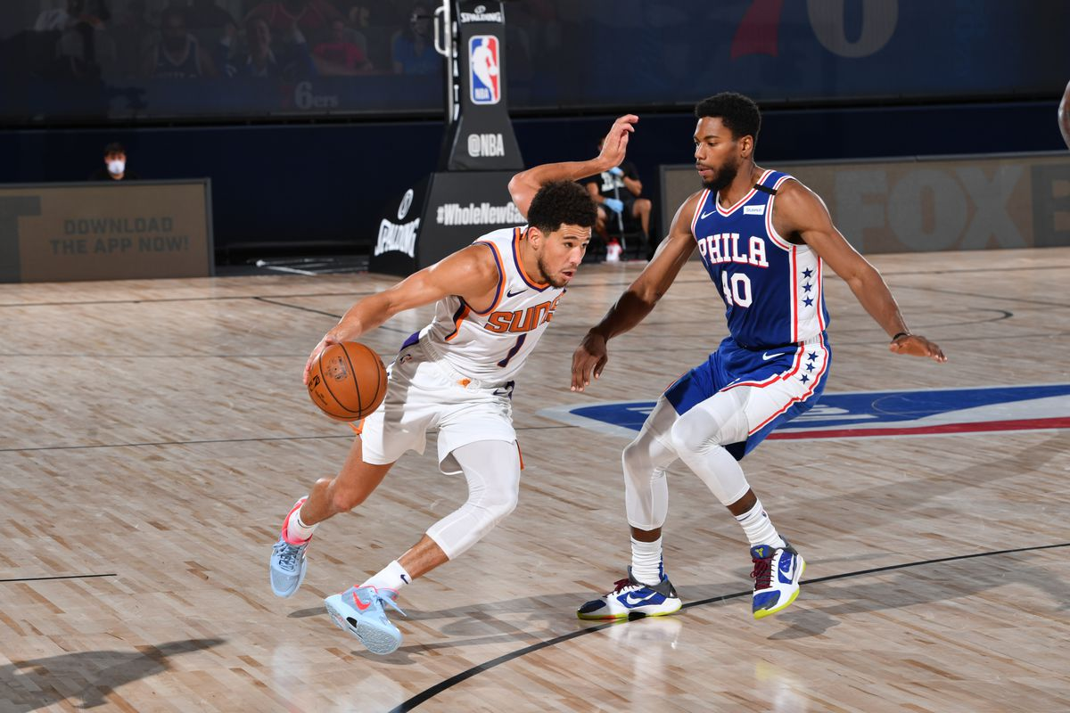 Devin Booker of the Phoenix Suns handles the ball against the Philadelphia 76ers on August 11, 2020 at Visa Athletic Center at ESPN Wide World of Sports in Orlando, Florida.