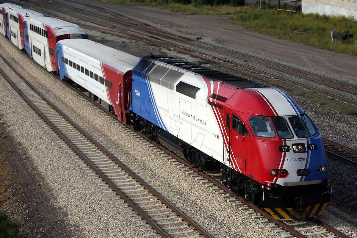 A FrontRunner train moves through in Salt Lake City on Thursday, Aug. 18, 2016.