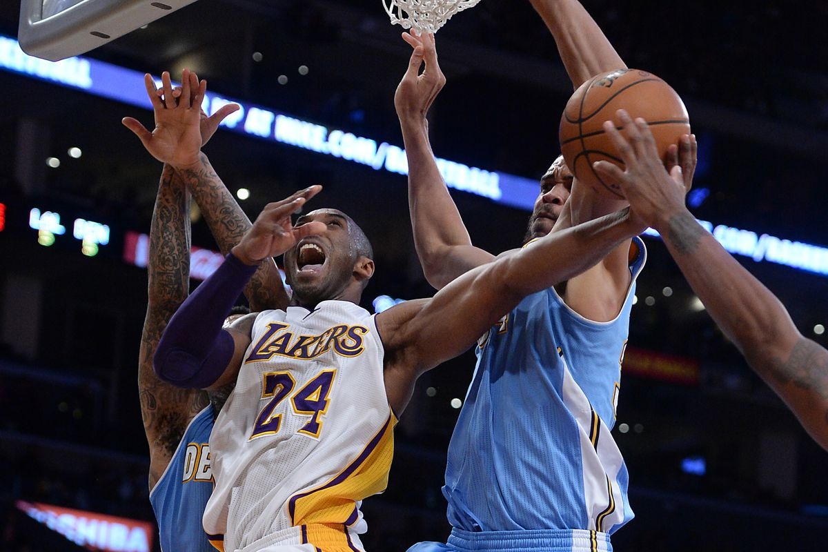 Kobe goes up for a contested lay up against the Nuggets