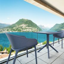 A perforated plastic bistro set on a balcony
