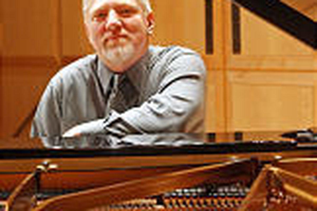 Pianist Dan Waldis at the keyboard in Libby Gardner Hall.