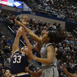 Notre Dame's Kathryn Westbeld (33) tries to shoot over UConn's Megan Walker (3) during the Notre Dame Fighting Irish vs UConn Huskies women's college basketball game in the Women's Jimmy V Classic at the XL Center in Hartford, CT on December 3, 2017.