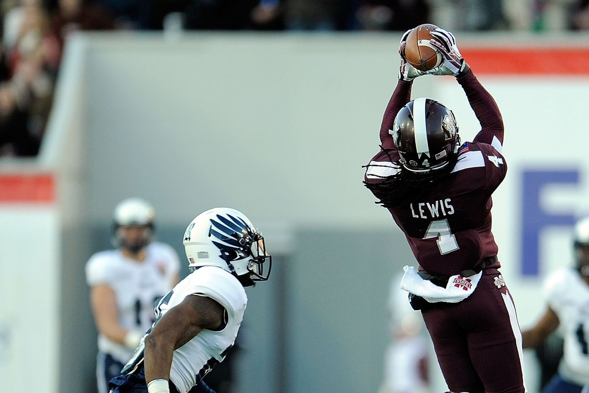 Jameon Lewis hauls in a pass against Rice en route to a career day for #4