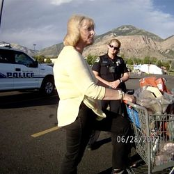 """Karmen Sanone, the self-described """"longtime friend"""" of Salt Lake County Recorder Gary Ott, center, talks with a Pleasant View police officer in body camera footage taken in a Harrisville parking lot on Wednesday, June 28, 2017. The footage shows the exchange Ott's family and Sanone had with police the day a judge signed a temporary order granting Ott's family legal guardianship amid concerns about his health."""