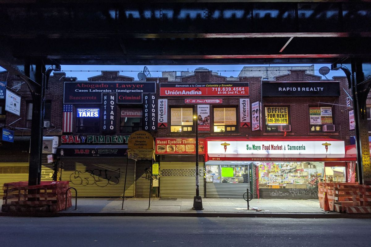 huttered storefronts in Jackson Heights during the coronavirus epidemic.