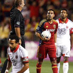 Javier Morales of Real Salt Lake is given a yellow card by referee Silvio Petrescu against DC United during their MLS matchup at Rio Tinto Stadium in Sandy Saturday, September 1, 2012