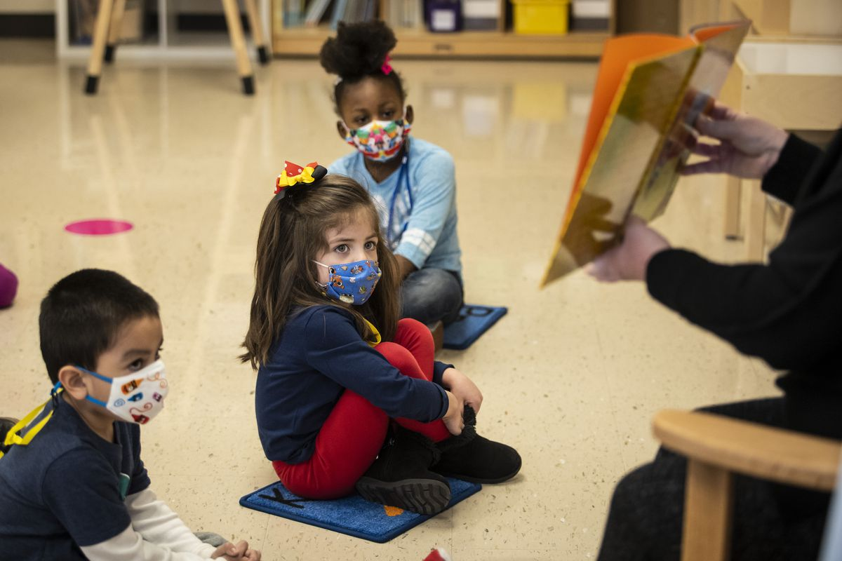 Preschool students listen as their teacher reads a story at Dawes Elementary School at 3810 W. 81st Pl. on the Southwest Side, Monday morning, Jan. 11, 2021.