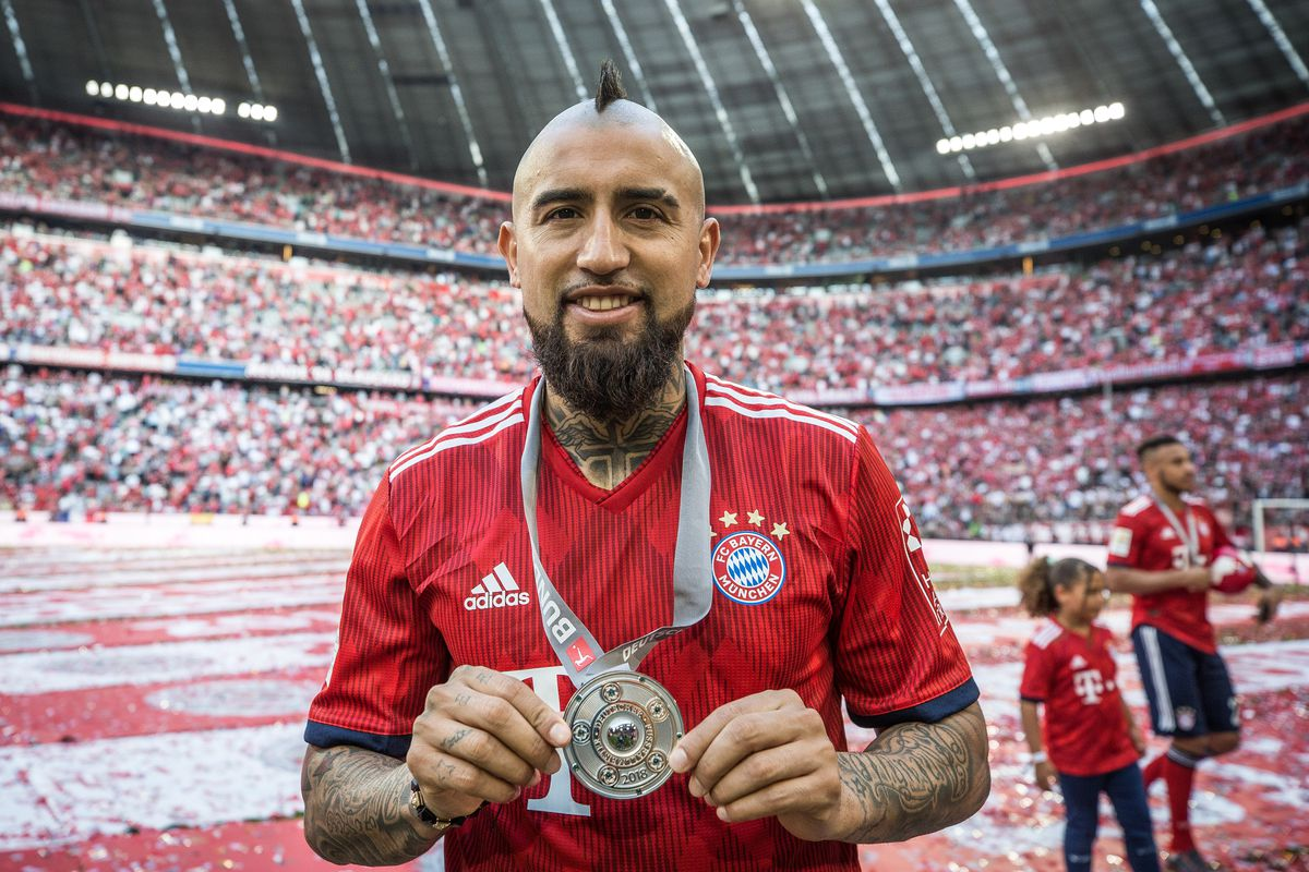 MUNICH, GERMANY - MAY 12: Arturo Vidal #23 of Bayern Munich shows a medal during the celebration for the 28th German football championship after the Bundesliga match between FC Bayern Muenchen and VfB Stuttgart at Allianz Arena on May 12, 2018 in Munich, Germany.