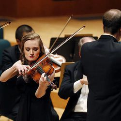 Maggie Ivory, left, and Rebecca Epperson perform on the violin and viola during the 55th annual Salute to Youth concert in Salt Lake City, Tuesday, Sept. 30, 2014.