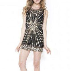 "<b>Pierre Balmain</b> Beaded Mini Dress, <a href=""http://otteny.com/catalog/clothing/dresses/pierre-balmain.html"">$1,275</a> at Otte"