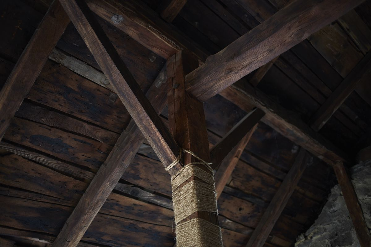The ceiling of the bedroom is completely crafted from wood.