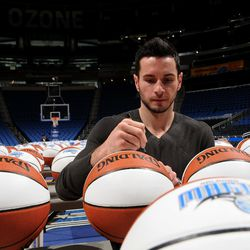 Orlando Magic guard J.J. Redick signs more than 300 basketballs during the internal team autograph session on Monday, November 26. All autographed items will be distributed back into the Central Florida community.