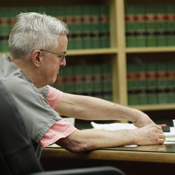 Steven Powell puts his fingerprints on legal documents after he was sentenced to 30 months in prison for voyeurism, June 15, 2012, in Tacoma, Wash. Diaries belonging to Powell, the father-in-law of missing mom Susan Powell, were released in Washington state Wednesday.