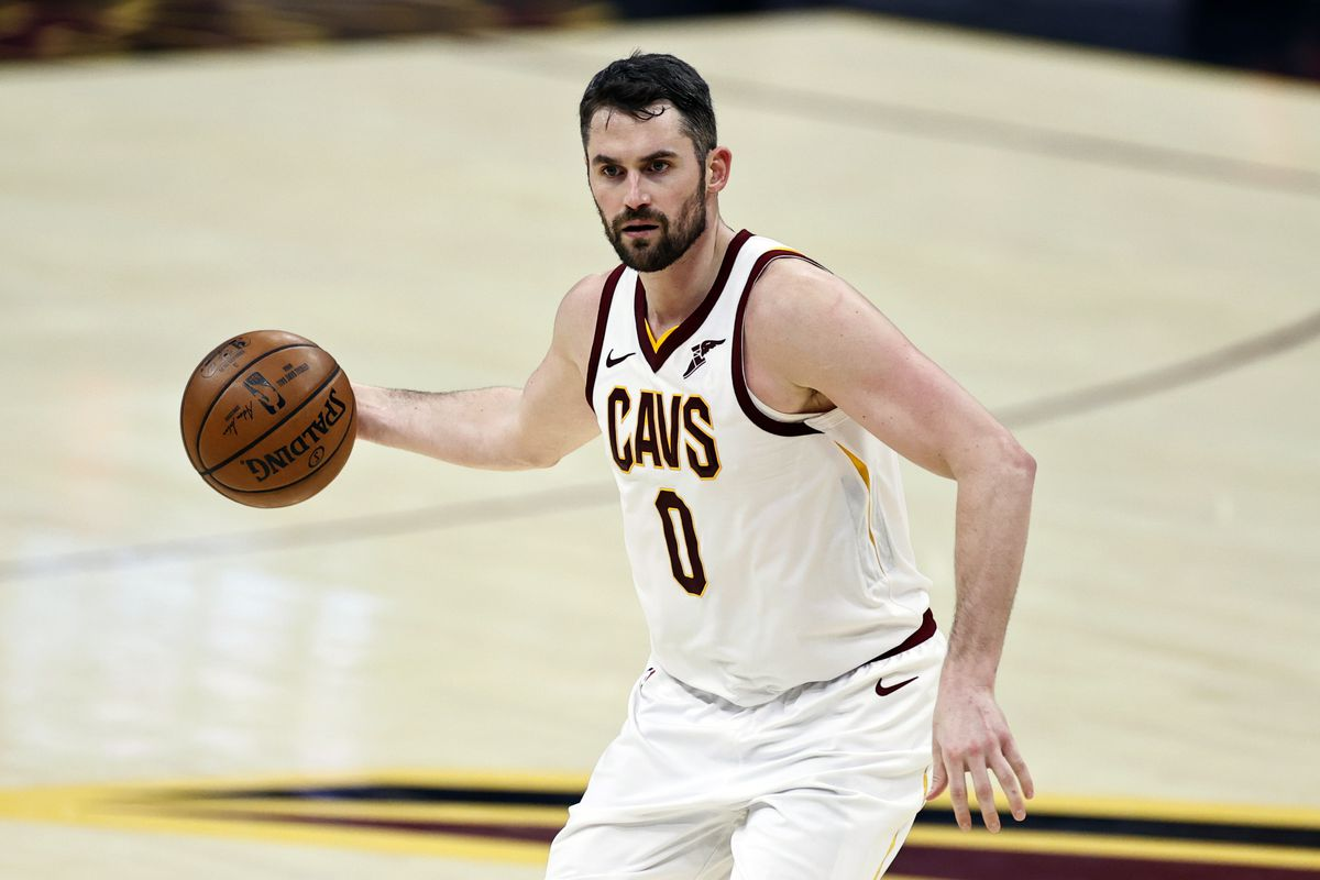 Cleveland Cavaliers' Kevin Love (0) dribbles against the Washington Wizards.
