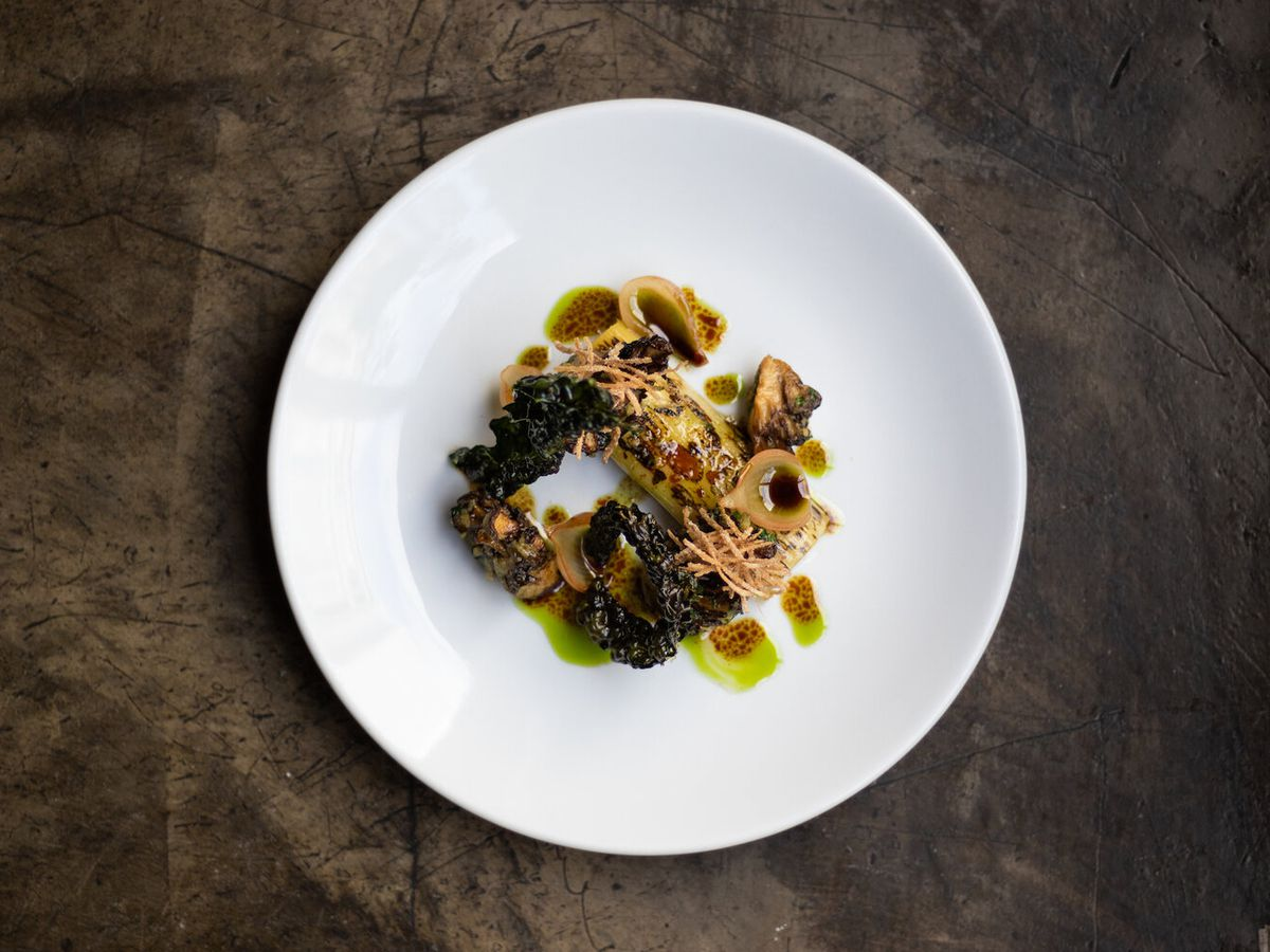 A wild mushroom dish shot from above on a white plate at Fallow