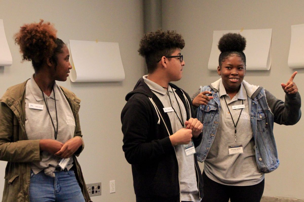 Caitlin Brinson (left), Christian Fuentes, and Aaliyah James lead a breakout session with fellow students on youth and education.