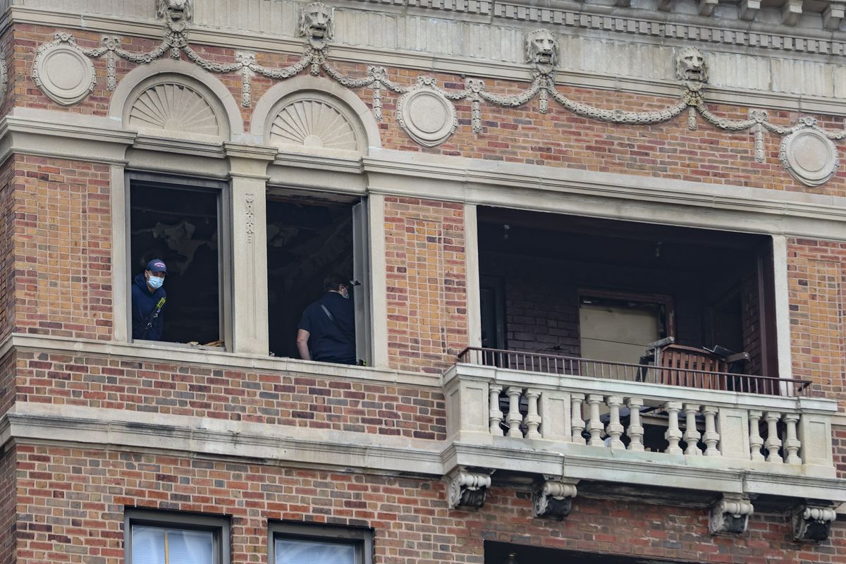 Fire department personnel inside the apartment Tuesday, Oct. 5, 2021, near the 400 block of West Wrightwood Avenue in Lincoln Park where a fire took place on the 7th floor and a man fatally jumped out of the window to escape.