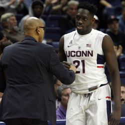 UConn associate head coach Raphael Chillious & Mamadou Diarra (21) during the Columbia Lions vs UConn Huskies men's college basketball game at Gampel Pavilion in Storrs, CT on November 29, 2017.