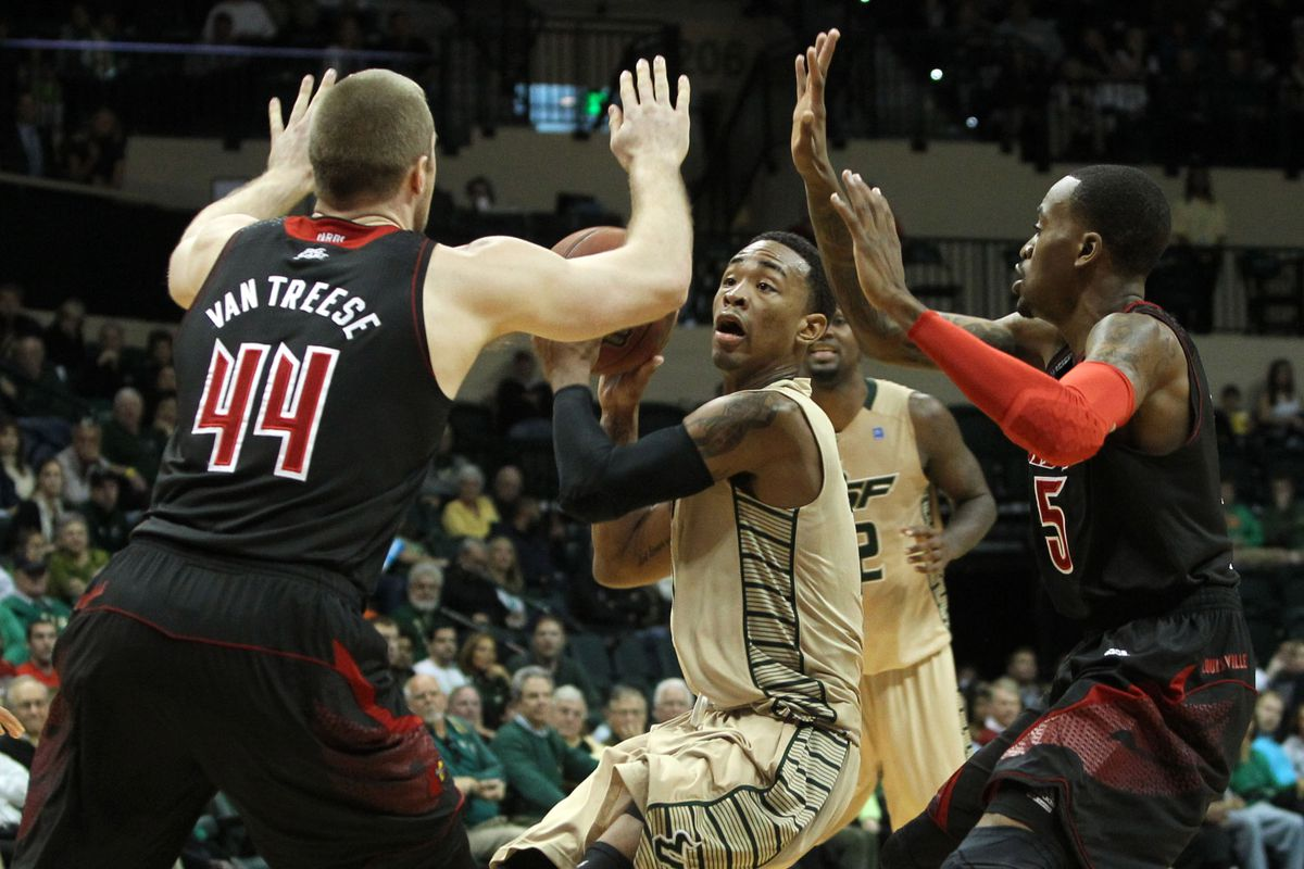 Anthony Collins with four hands in his face, which happens about 10 times a game.
