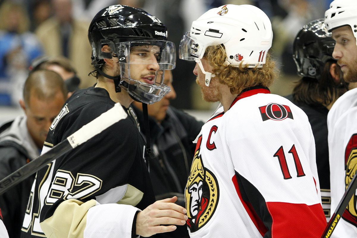 Sidney Crosby shakes the hand of a real captain.