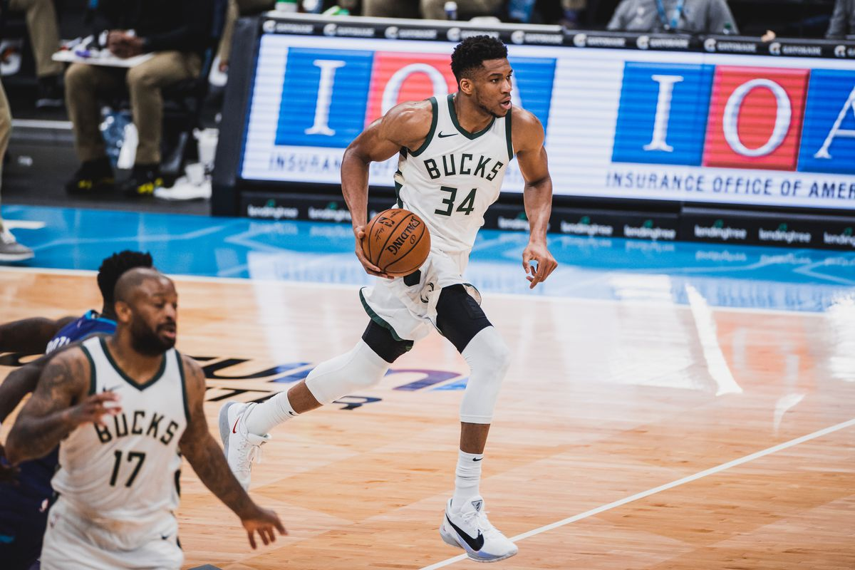 Giannis Antetokounmpo of the Milwaukee Bucks dribbles the ball against the Charlotte Hornets on April 27, 2021 at Spectrum Center in Charlotte, North Carolina.