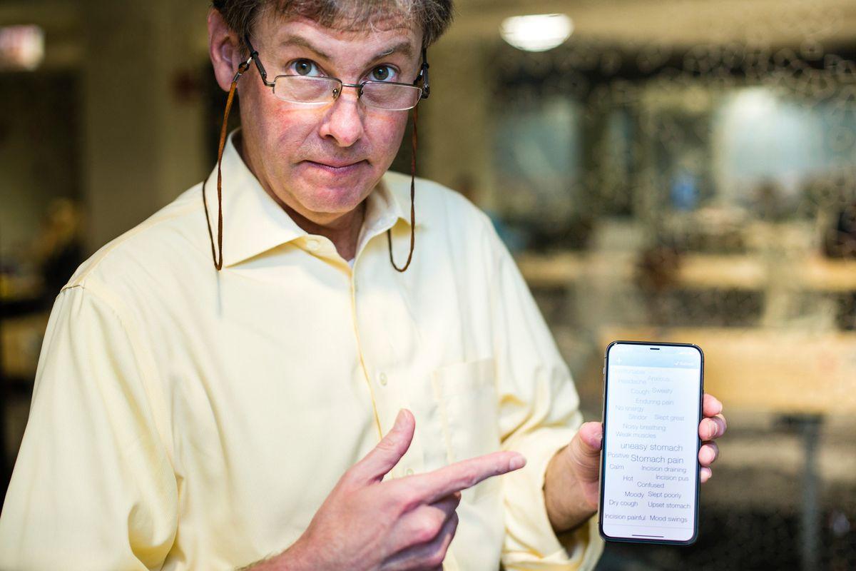 Tom Riley displays his TapCloud app.