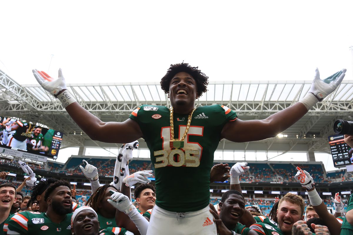 Miami Hurricanes defensive lineman Gregory Rousseau celebrates wearing the turnover chain during the first quarter of a football game against the Central Michigan Chippewas at Hard Rock Stadium.